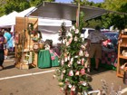 Christmas ornaments and other cool items on display at craft fair