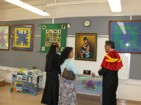 Student quilts being admired