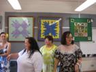 Former QLS staff: Pua Wilmington, Gwen Barcarse, and Karen Tsukiyama looking over the display room