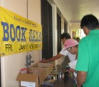 Shopping for bargain books at the Kaimuki Library's book sale